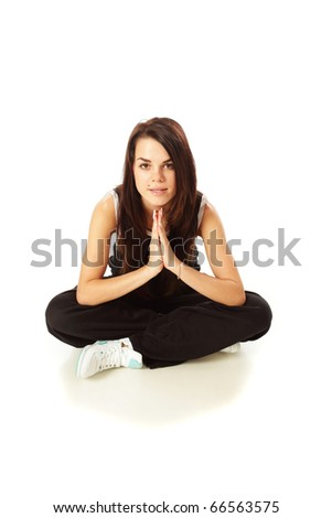 Young stylish woman sitting on the floor isolated on white background