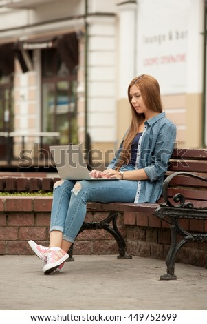 Young stylish woman with a laptop.