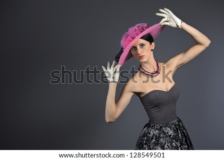 Young stylish woman with purple retro hat - stock photo