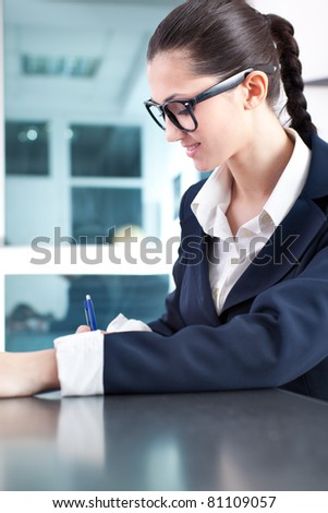 young success businesswoman working in office - stock photo