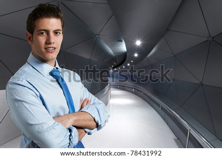 Young successful business man at hallway - stock photo