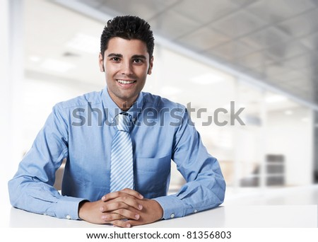 Young successful business man at office - stock photo