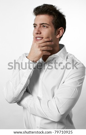 Young successful business man isolated white background with copy space - stock photo