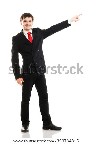 Young successful business man pressing imaginary button isolated on white - stock photo