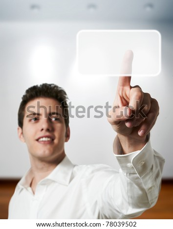 Young successful business man touching digital screen display at office - stock photo