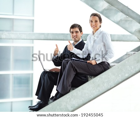 Young successful business partners in a office building. - stock photo