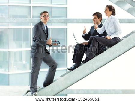 Young successful business people in a office building. - stock photo