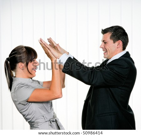 Young Successful business with give me 5 - stock photo