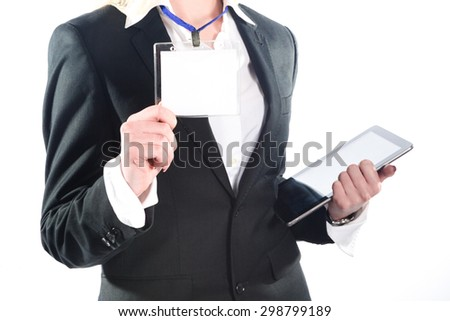 Young successful business woman shows her badge - stock photo