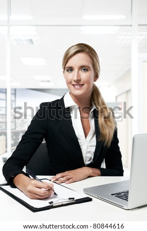 young successful business woman working at office - stock photo