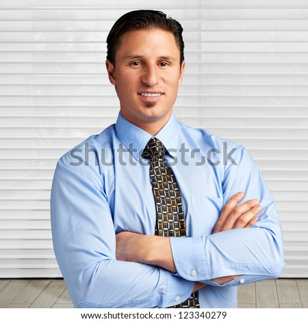 Young successful businessman at office - stock photo