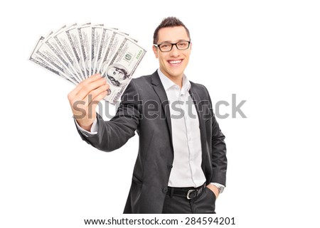 Young successful businessman holding a stack of money and looking at the camera isolated on white background - stock photo