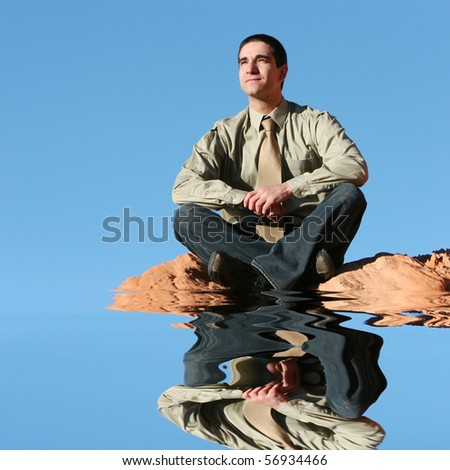 Young successful businessman posing outdoors - stock photo