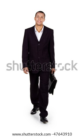Young successful businessman with a briefcase on a white background - stock photo
