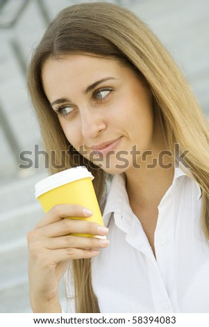 Young successful businesswoman having a coffebreak
