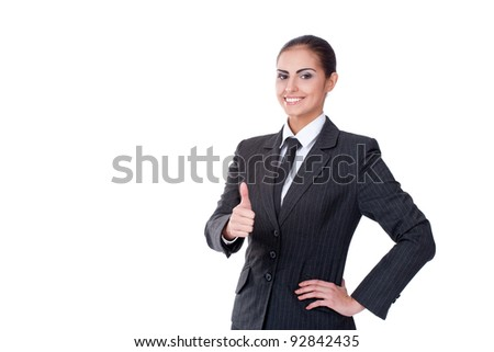 Young successful businesswoman looking on camera and smiling