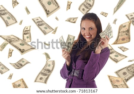 Young successful businesswoman on dollars background - stock photo