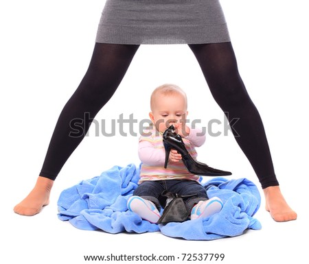 Young successful businesswoman with here little baby - close up. Motherhood metaphor. - stock photo