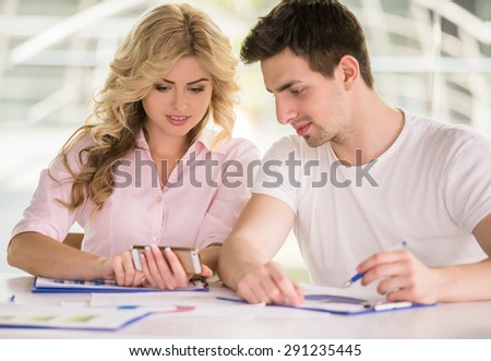 Young successful couple dressed casual working together on project.