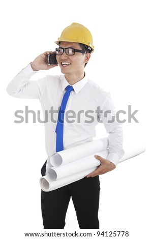 Young successful engineer talking on the phone