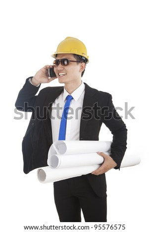 Young successful engineer talking on the phone - over a white background