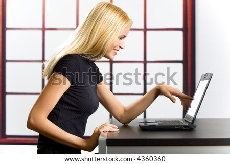 Young successful happy smiling business woman on laptop - stock photo