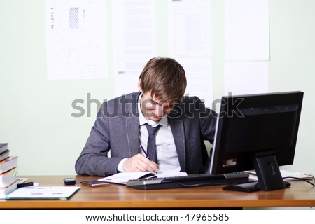 Young successful man in his office