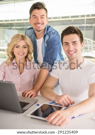 Young successful man showing business plan to his colleagues. - stock photo