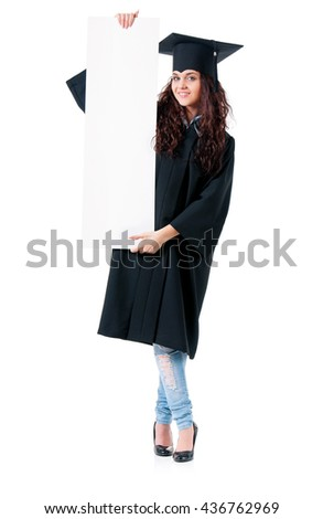 Young successful woman graduating from college holding a blank signboard, isolated on white background - stock photo