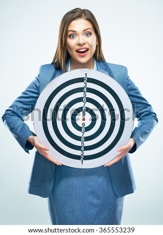 Young surprised  business woman holding target. Isolated studio portrait. Business suit, long hair. - stock photo