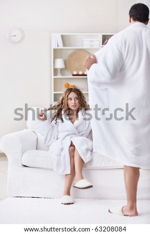Young surprised girl and a man opened its robe - stock photo