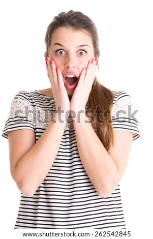 Young surprised woman on white background - stock photo