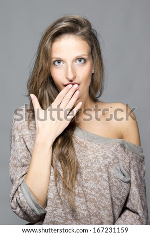 "Young surprised woman ""oops"""