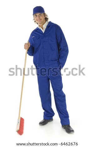 Young sweeping man in blue workwear. Isolated on white background - stock photo