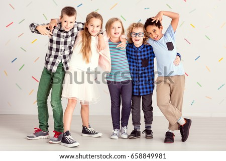Young sweet children standing together in line