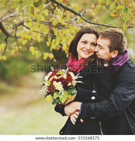 young sweet couple together having date, autumn - stock photo