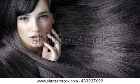young sweet girl with beautiful hands and fresh skin, natural makeup and shining hair - stock photo
