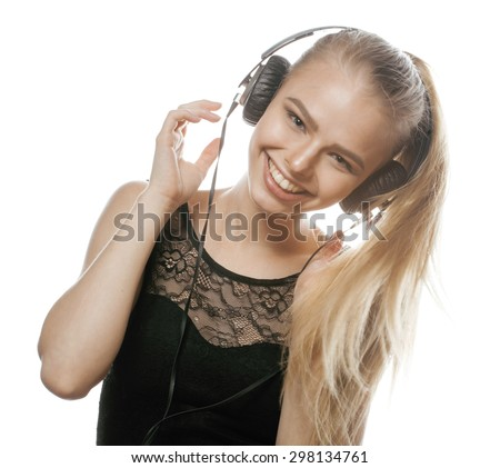 young sweet talented teenage girl in headphones singing isolated - stock photo