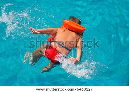 Young swimmer in the sea