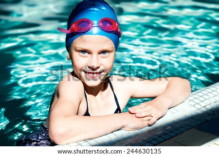 young swimmer training in the swimming pool - stock photo