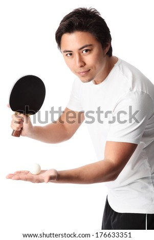 Young table tennis player wearing a white tshirt with black shorts. White background.