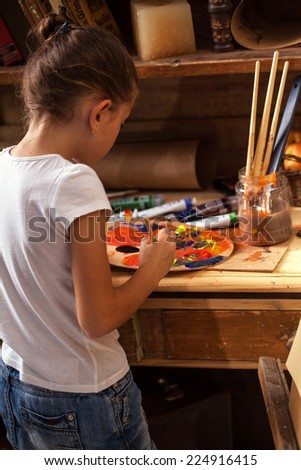 Young talented girl artist painter - stock photo
