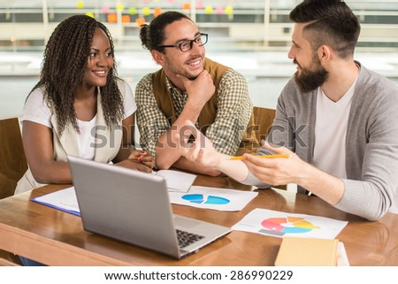 Young talented man presenting new project to colleagues, - stock photo