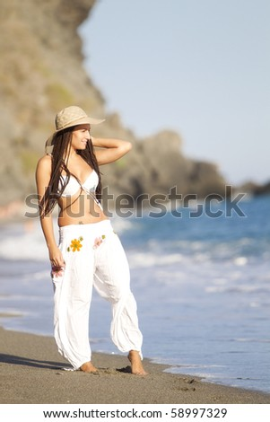 Young tanned girl looking to the horizon - stock photo