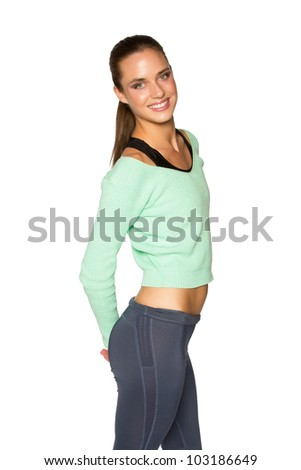 young tanned woman in sportswear posing isolated over white background