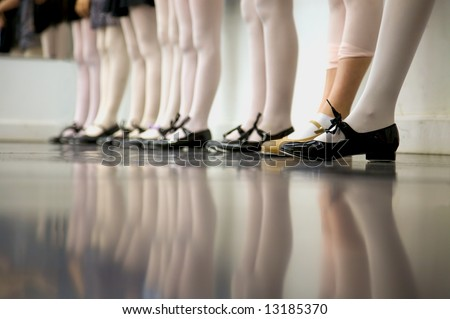 Young tap dancer... low angle shot of just feet and legs - stock photo