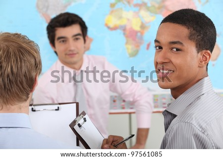 young teacher and pupils in university - stock photo