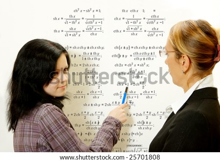Young teacher in the class room - stock photo