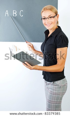 Young teacher portrait, conceptual image of education - stock photo