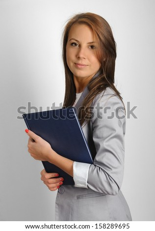 Young teacher with class register - stock photo